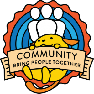"Wapuu, WordPress mascot, holding up a sign saying ""Community: Bring people together"""
